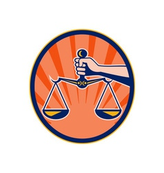 Hand holding scales of justice vector image vector image