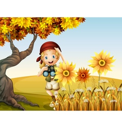 A girl holding a telescope near the sunflowers vector image