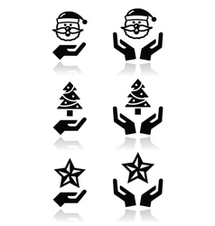 Hands with christmas icons - santa claus tree vector image vector image
