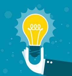Innovation - hand holds shining light bulb vector
