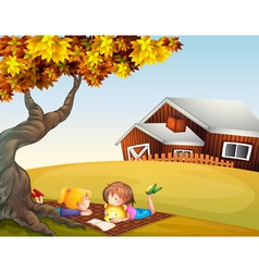 Kids reading under a big tree vector image vector image