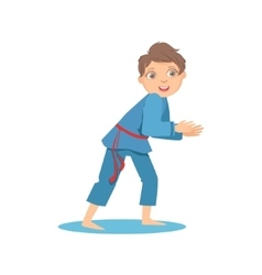 Boy in blue kimono in sparring fight on karate vector