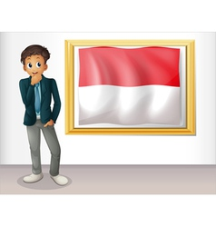 A boy with the framed flag of Indonesia vector image