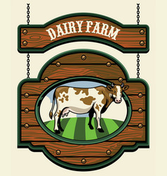 dairy farm sign with cow image vector image