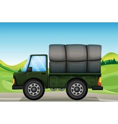 A military truck in the road vector image