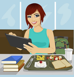 Student girl using tablet in fast food restaurant vector