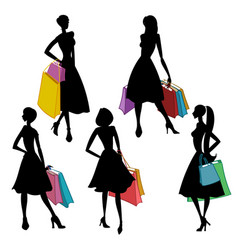 Silhouettes of women with shopping bags vector