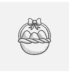 Basket full of easter eggs sketch icon vector