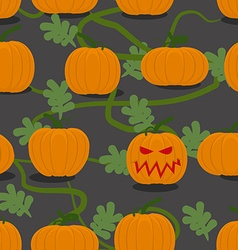 Scary halloween pumpkin among plantation of vector