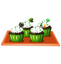 A tray with four chocolate cupcakes vector image vector image