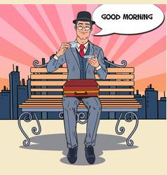 Pop art businessman drinking tea on the morning vector