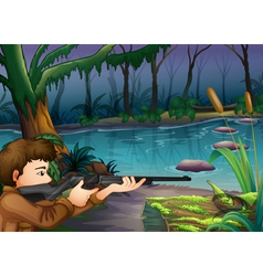 A hunter near the river vector