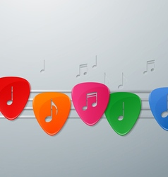 Colorful guitar picks with music notes vector