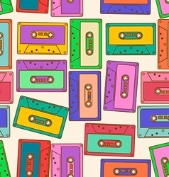 Seamless pattern of retro audio cassettes vector