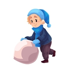 Little boy in winter clothes making a snowman vector