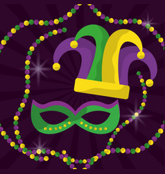 Mardi gras mask with feathers and jester hat beads vector
