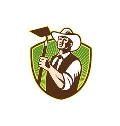 Organic farmer holding grab hoe shield vector