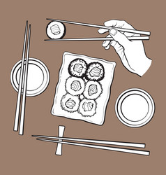 Japanese sushi set serving plate hand holding vector
