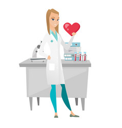 Caucasian doctor holding a big red heart vector