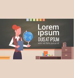 female teacher in classroom over chalk board vector image