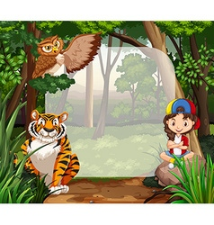 Little girl and wild animals in jungle vector image