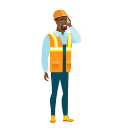 builder talking on a mobile phone vector image