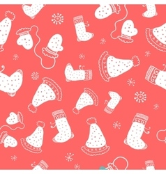 Seamless pattern with christmas socks mittens and vector image