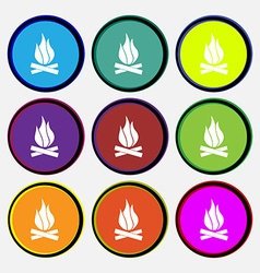 A fire icon sign nine multi colored round buttons vector