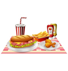 Sandwiches and fried chicken on the table vector image