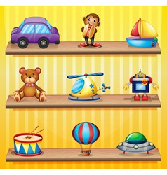 Different toys arranged at the wooden shelves vector image