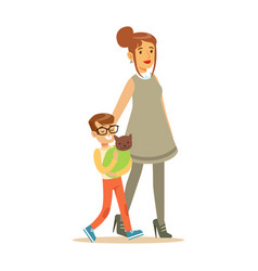 young boy with his mother holding a wrapped cat vector image vector image