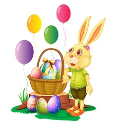 Easter bunny and basket of eggs vector image vector image