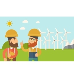 Two workers talking infront of windmills vector image vector image