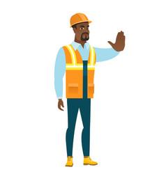 african-american builder showing stop hand gesture vector image vector image