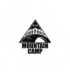 Black emblem with the wood tent and the mountain vector image