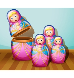 Four colorful russian dolls vector