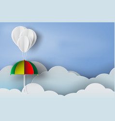 paper art of white balloon and colorful umbrella vector image vector image