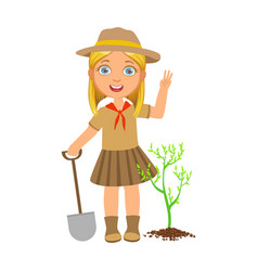 Cute scout girl with a shovel planting green tree vector