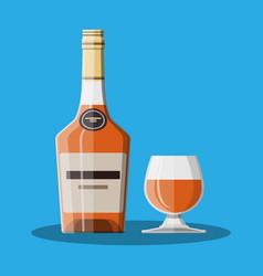 Cognac bottle and glass cognac alcohol drink vector