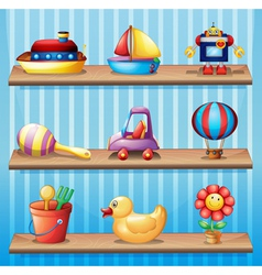 Three wooden shelves with different toys vector