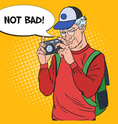 Senior man taking picture with camera pop art vector