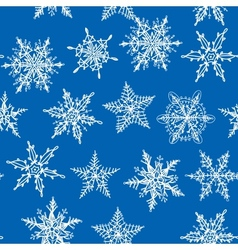 Seamless winter background with snowflakes on blue vector