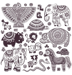 Vintage set of isolated ethnic animals and symbols vector image