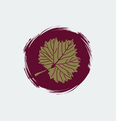 Gold grape leaf on round burgundy background vector