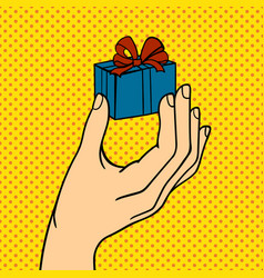 Pop art hand with gift box vector