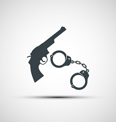 Gun and handcuffs vector image