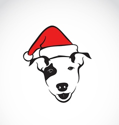 Dog and santa hats vector