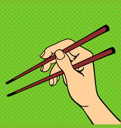 Pop art hand with sushi chopsticks vector