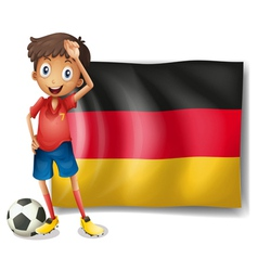 A football player in front of the flag of Germany vector image