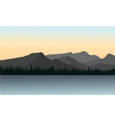 Silhouette of mountain and lake vector